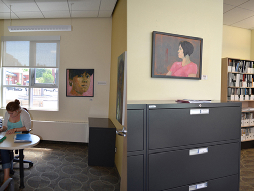 "David Kearn's portraits are seamlessly integrated into the office space of the AOE: (left) ""Lanie"" (his sister-in-law), Oil of Canvas; (right) ""Mindy"", Oil and Acrylic on Canvas"