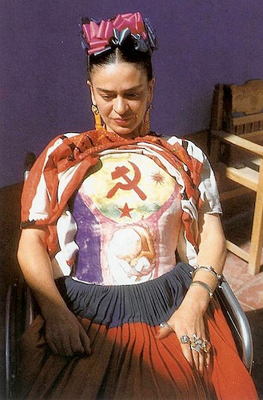 Photo of Frida wearing the body cast she painted depicting hammer, sickle and embryo.