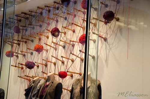 Club Monaco's display of spindles and wool... such a smooth move to showcase the paraphernalia used in the history of fabric/fibre making along with their fashions. (Photo from Meliasson Blog ... see link below)