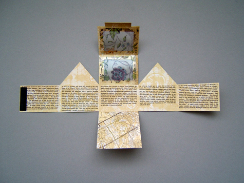 Michelle Casey: Golden Triangle Project (Interior view), Assemblage: scrapbooking paper, acetate, ink, rubberstamp, magnets), 2009